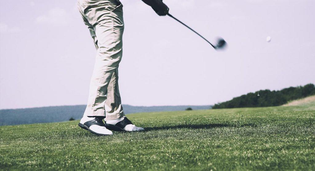 man play golf