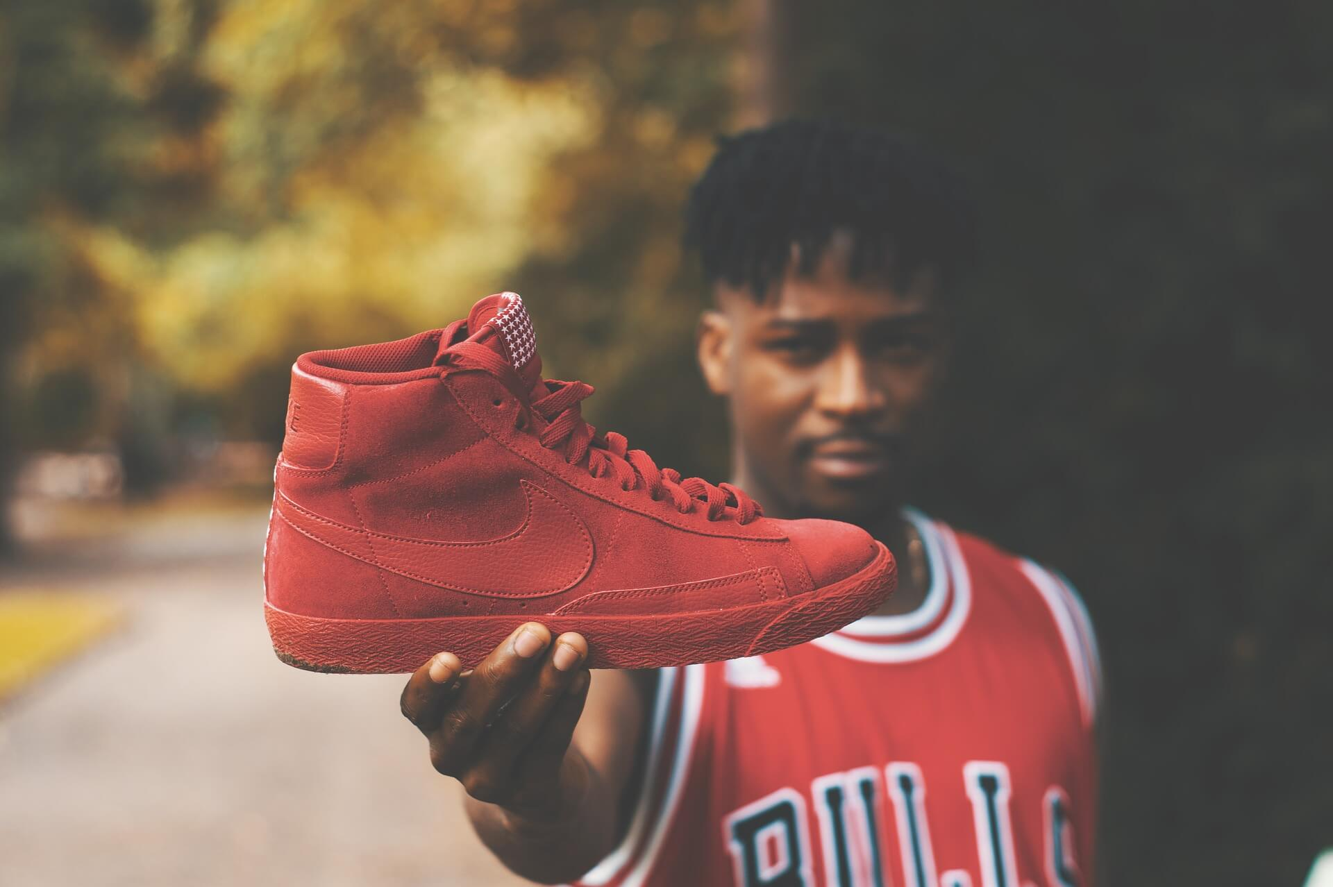 Man holding red sneaker